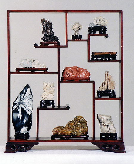 A variety of small stones displayed in ...
